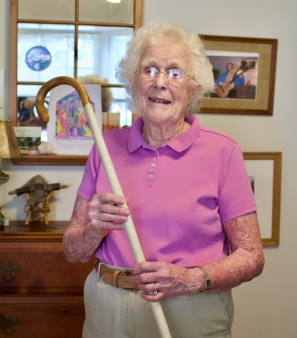 Narrator Alice Bradshaw with the cane she was issued as an Air Raid Warden (Photo Credit: Patricia Rana)